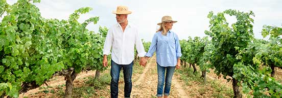 Couple-Walking-Through-Vineyard-Related-Products
