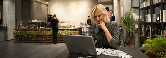 Woman-at-cafe-using-computer-Related-Products